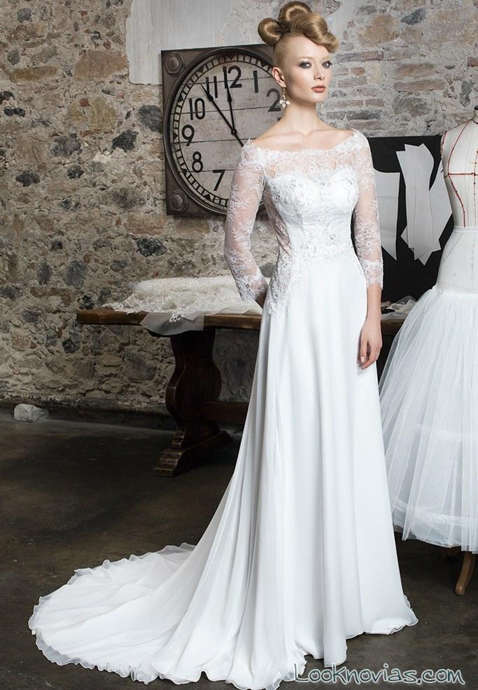 novia de blanco con vestido de mangas