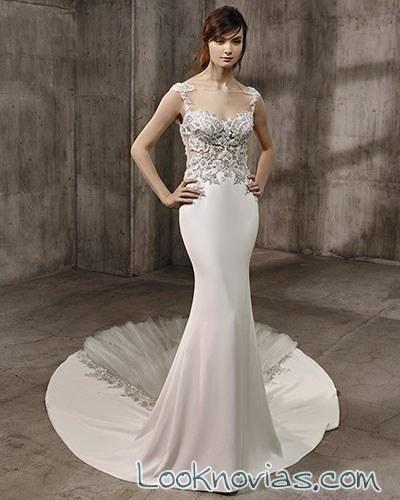 vestido de novia con falda lisa y cuerpo de pedrería